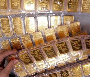 Vàng chạm mức 970 USD/oz